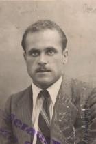 Giovanni Ratti nella fotografia del tesserino aziendale.